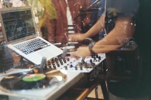Person Using Audio Mixer Controller